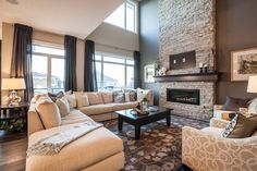 Aspen Woods Show Home transitional-living-room Transitional Lighting, Transitional Living Rooms, Aspen Wood, Color Combos, Future House, Loft, Couch, House Styles, Woods