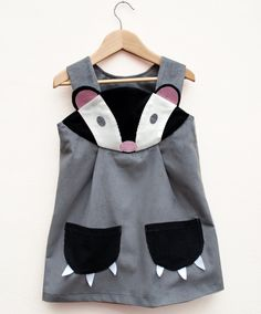 Badger girls dress by wildthingsdresses on Etsy, via Etsy.    KATHERINE needs this one