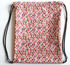 punk projects: Drawstring Backpack   good, simple tutorial ...read through it first to catch the missing early step :-) cute fabric too!