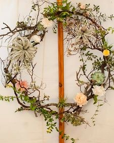 Airy Arch    This wreath of branches, air plants, succulents, vines, and fresh blooms is the opposite of a dence holiday arrangement making it perfect for spring or summer.