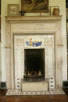 Fireplace with painted tiles by Vanessa Bell at Monk's House, in her sister Virginia Woolf's bedroom. Painted Fireplaces, Artists Homes, Charleston House, Fireplace Tiles, Vanessa Bell, Bell Art, Bloomsbury Group, Painted Tiles, English Interior