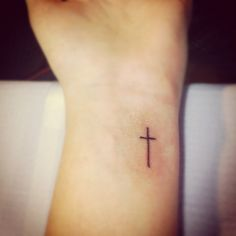 """This is my cross tattoo.  I have always wanted a simple cross tattooed somewhere on my body, as a simple reminder. So that is what I did."""
