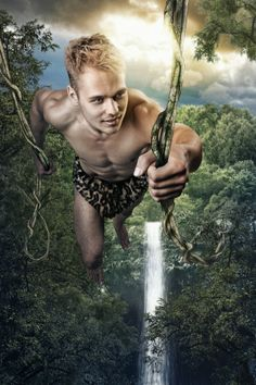 Tarzan swinging from the vines, inspired by a movie poster. To get the pose right, I had to use 3 different images of Christian. The background was put together tree by tree.