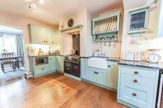This is our old kitchen and I'd like the same black/grey granite with lots of marbling. The same handles too.