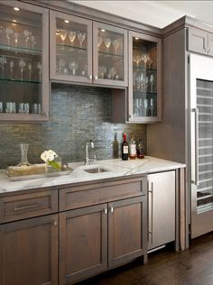 "Backsplash is Weave Glass 1×4 offset in Shadow. The sink is just a plain-jane stainless undercount in a 15×15 size and countertop is ""statua..."