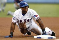 Texas Rangers' Adrian Beltre slides in safely into third on his run-scoring triple off of Minnesota Twins starting pitcher Samuel Deduno in the first inning of a baseball game Friday, Aug. 24, 2012, in Arlington, Texas. (AP Photo/Tony Gutierrez). This guy's on fire!