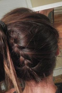 The Bajo Braid http://www.runnersworld.com/hot-weather-running/eight-runner-tested-hairstyles/the-bajo-braid