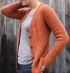 A long lean tomboy cardigan with Aran style texture, without the bulk. Knit seamlessly in a draping worsted weight yarn with sweet, easily memorized 2 and 3 st cables framed by textured stitch panels.
