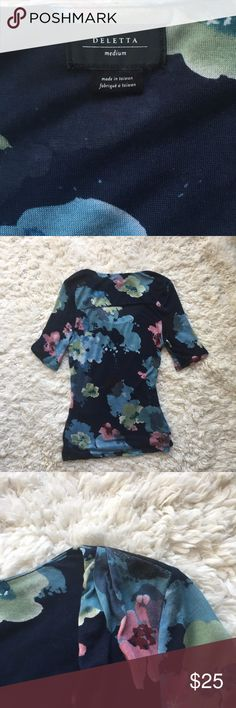 Anthropologie Deletta Floral Ruched Top Anthropologie Deletta Navy Floral Top. Size M. Has ruching at the right bottom and both tops of the shoulders as shown. Has 2 small pulls. One pull on the arm as shown, other is hidden by the ruching as shown. Cute top! If you have any questions let me know! Offers Welcome. Anthropologie Tops