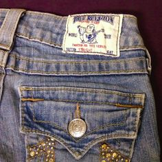 Original Straight Leg True Religion Jeans From before the styles had human names. Original straight leg TR. The perfect fit, medium denim weight with stretch. Has a tiny working flap pocket in front. Broken in, no flaws. Buddha patch and Buddha print material inside front pockets. Small amount of half tear distressing on thighs, copper color bling on back, all intact, no damage anywhere. True Religion Jeans Straight Leg