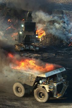 Mining burning coal by rocbolt on Flickr. Not a job I would have.