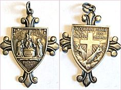 Large Signed Antique Cross Medal Ave Maria St Dominic Virgin Mary  (Image1)Giant antique Holy Medal cross featuring Cherubs / angels, The blessed Mother Virgin Mary (Ave Maria) and the Christ child Jesus with saint Dominic as Our Lady of the Rosary with writing in Spanish and a signed ornate back featuring a cross and the hands of Jesus and reads: instaurare omnia in christo per mariam.  Heavy weight silver metal. Writing is in Italian I believe. Excellent condition. Perfect size for a man