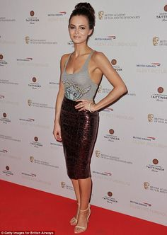 Kara Tointon beats the heat in a low-cut vest and animal-print skirt at film party | Mail Online