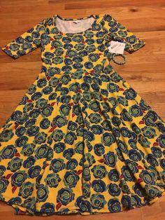 Lularoe Nicole L dress disney roses yellow background w. rose bracelet unicorn…