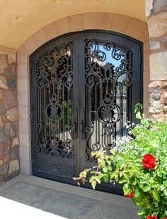 Striking wrought iron doors for front entry way