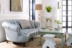 Wonderfully eclectic living room. Crazy in love with that pale blue leather sofa!
