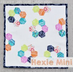 """Mini Hexie Quilt - I think this measures just under 20"""".   For the challenge, I might use a smaller hexie.  Tutorial and video."""