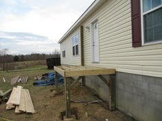 The front porch is under construction -- the farmhouse is almost done!
