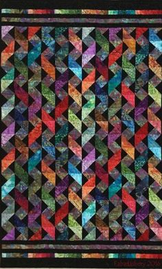 "These are straight columns of triple square triangle blocks. The real challenge is getting the right colors to alternate light & dark, changing hues in a ""natural"" way. Well beyond my current color abilities ~ Colourwave Quilt"