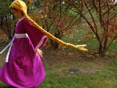 """DIY Rapunzel costumes for a Disney princess party.  Other princess party ideas on this blog include buying plastic wine glasses (""""goblets"""") for the partyers to decorate with plastic gems, and cardboard Rapunzel towers to decorate.  This blog is my favorite blog in the world, if you couldn't tell."""