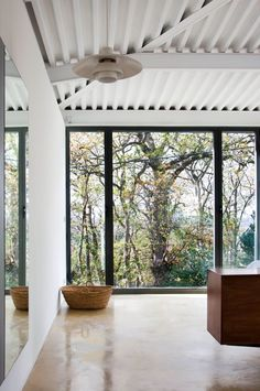 Polished concrete + black windows framing the outdoors
