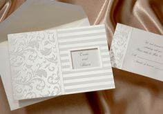 Vintage Flourish Wedding Invitation 42% Off https://www.yourinvitationplace.com/Detail.aspx?ItemNum=T+402&WebName=mplus This lovely invitation has pearl stripes and an intricate pattern. Your names peak through a window on the front.