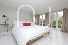 Loft conversion with white flooring and double French doors