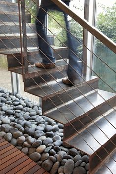 Modern Passive Solar House Responsible for Healthy Living: Industrial Indoor Staircase Made Of Steel Combined With Gravels And Wooden Deckin...