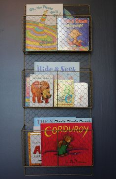 Magazine Holder Baby Book Organization - A wire magazine holder adds a new twist to the nursery wall library.