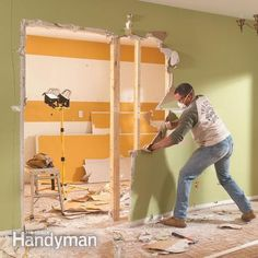 Remove the drywall where the load bearing beam will go.