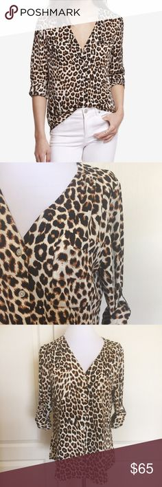 """Express Leopard Convertible Sleeve Top Blouse S Express convertible sleeve leopard / cheetah print shirt / blouse. Size small. New without tag. Button front. Convertible sleeves can be worn long, or rolled up & buttoned for a different look. True to size for Express. Approx 20"""" across the underarms & 27"""" from top of shoulder to back bottom hem, lying flat. The poly fabric drapes beautifully & is resistant to wrinkles. It's exactly like a Portofino shirt, but without the collar.   Smoke-free…"""