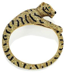 A coloured diamond and onyx Tiger bangle, by Cartier