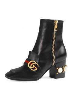 """Gucci leather ankle boot with glass pearl and small studs on heel. 3"""" stacked block heel; 7""""H shaft, 11.5"""" top circumference. Square apron toe. Blue/red/blue web with GG detail. Side zip eases dress."""