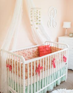 Stylish and fresh peach and mint baby bedding perfect for every baby girl's nursery from @lottidababy! #pnapproved