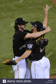 Download this stock image: Pittsburgh Pirates closer Jason Grilli hugs first baseman Gaby Sanchez (R) after St. Louis Cardinals Daniel Descalso is retired for the final out in game 3 of the NLDS at PNC Park in Pittsburgh, Pennsylvania on October 6, 2013. The Pirates won 5-3 to take a 2-1 lead in the five-game series. UPI/Pat Benic - W02DWM from Alamy's library of millions of high resolution stock photos, illustrations and vectors. Pnc Park, Game 3, Pittsburgh Pirates, St Louis Cardinals, Live News, Hugs, Pennsylvania, Finals, Closer