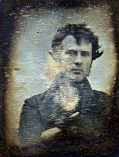 """This is the first photograph of a person.   Philadelphia, November 1839. """"Robert Cornelius, self-portrait facing front, arms crossed. Inscription on backing: The first light-picture ever taken. 1839."""" One of the first photographs made in the United States, this quarter-plate daguerreotype, taken in the yard of the Cornelius family's lamp-making business in Philadelphia. I love his face... the way he is looking at the camera. Do you think he has ANY clue about what's to come?? How much what…"""