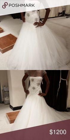 Wedding dress Reem Acra wedding dress never wore. Retails for 9900$ plus tax Reem Acra Dresses Wedding