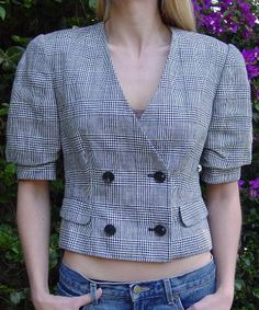 This black and white vintage checkered Giorgio Armani jacket is 63% acetate and 37% rayon, and was made in Italy.