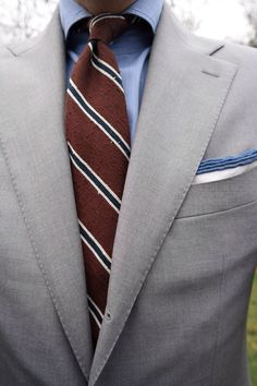 Grey suit, blue shirt, tipped p square, brown sulka raw silk brown repp tie