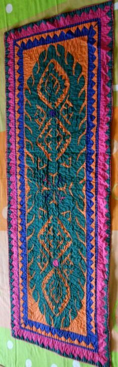 A ralli quilted table runner.