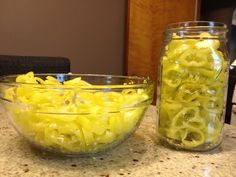 For sandwiches! banana peppers (about 3 cups white vinegar acidity) 2 cups water 2 tablespoon kosher salt 1 tablespoon sugar 1 garlic clove per jar, minced - 1 lb. of banana peppers filled roughly 2 quart sized mason jars Fill jars with pepp Canned Food Storage, Stuffed Banana Peppers, Canning Recipes, Canning Tips, Fermented Foods, Sandwiches, The Fresh, Vegan, Pickles