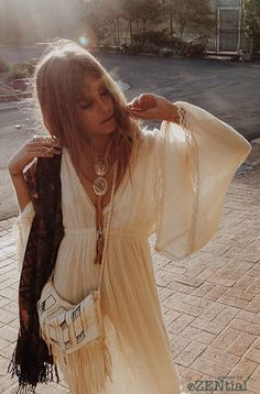 love the flared sleeves on this dreamy cream vintage dress