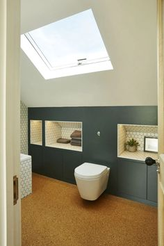 If you're designing a bathroom to suit a loft conversion and are looking to tackle an awkward space, consider building handy recesses into the eaves. # Loft conversions: 23 expert tips for getting it right Attic Shower, Small Attic Bathroom, Upstairs Bathrooms, Bedroom Small, Loft Ensuite, Loft Bathroom, Bathroom Interior, Bathroom Storage, Bathroom Bin