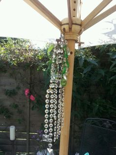 use up old crystals from chandeliers to attach to parasol peg..