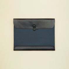 This is a legal size envelope to fit an iPad. Made with pressed cotton and leather. Cushioning added for extra protection. The adjustable button closure allows for some expansion for papers or a notebook. Pen sleeve on backside, 2 card pockets.