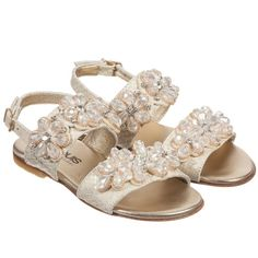 Girls pink sandals by Unisa, with a sparkling Swarovski crystalstrim. Made with soft suede straps across the foot and around the ankle, fastening with an adjustable buckle. They have a soft leather inner sole and a rubber sole with textured patterns providing extra grip.