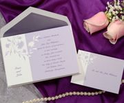 T3665  price per 100: $129.90  This purple and white invitation features the names of the bride and groom.