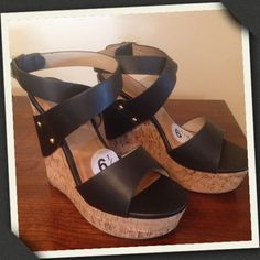Black Wedge New with Tag, Never Worn other than to try on! Black wedge with gold tone hardware. straps cross  around ankle. Cork base with rubber sole.  Size 6.5. No box. Shoes Wedges
