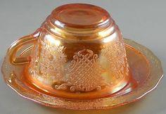 Carnival Glass Cup & Saucer Marigold Vintage  http://www.ebay.com/itm/Carnival-Glass-Cup-Saucer-Marigold-Vintage-/370603322749?pt=LH_DefaultDomain_0=item5649aded7d#ht_3324wt_754