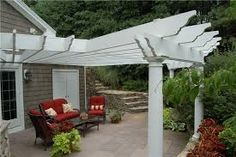 Beautifully remodeled white wooden covered patio trellis!